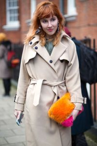 wear a fur clutch